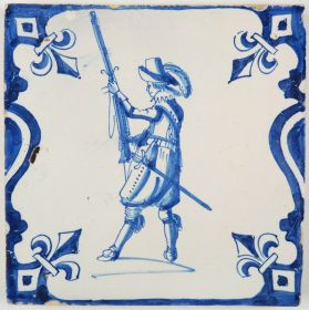 Antique Delft tile with a soldier in blue based on an engraving by Jacob de Gheyn II, 17th century
