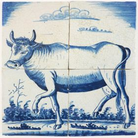 Antique Delft tile mural with a cow facing to the left, early 19th century