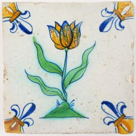 Antique Delft tile with a beautiful polychrome tulip, decorated with 'fleur-de-lis' corner motifs, 17th century