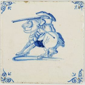 Antique Dutch Delft tile in blue with a horse rider firing his rifle, 17th century