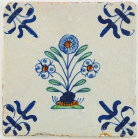 Antique Delft tile with three polychrome flowers, first half 17th century