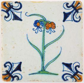 Antique Dutch Delft tile with a double polychrome flower, 17th century Gouda