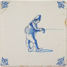 Antique Delft tile with a man in blue spinning a rope, 17th century