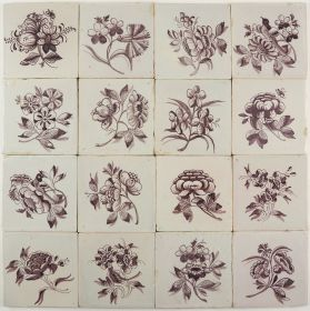 Antique Delft wall tiles with large flowers, 18th/19th century