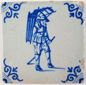 Antique Delft tile with a peddler, 17th century