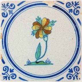Antique Delft tile with a polychrome Dianthus flower, 17th century