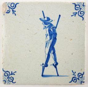 Antique Delft tile with a child walking on stilts, 17th century