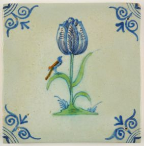 Antique Delft tile with a polychrome tulip and a small bird, 17th century