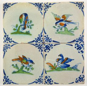 Set of four Delft tiles with colorful birds, 17th century Gouda