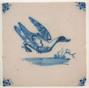 Antique Delft tile in blue with a duck preparing to land in water, 18th century