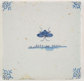 Antique Delft tile with a butterfly, 17th century