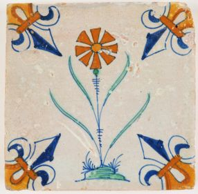 Antique Delft polychrome tile with a dianthus carnation flower, 17th century