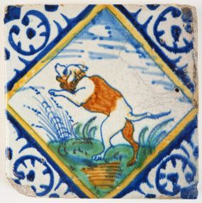 Antique Delft tile with a polychrome dog in a diadmond square, early 17th century