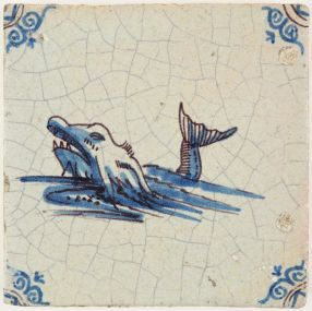 Antique Delft tile in blue with accents in manganese depicting a sea monster, 17th century