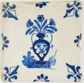 Antique Delft tile in blue with a mascaron on a flower vase, 17th century