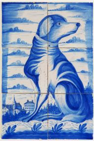 Antique Delft tile mural in blue with a dog infront of a Dutch city scene, 19th century