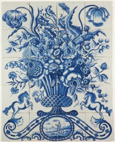 Antique Delft tile mural with a large and richly decorated flower vase in blue, 19th century