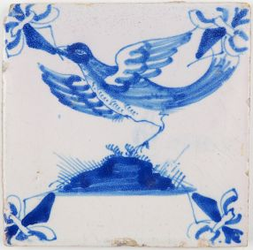 Antique Dutch Delft tile in blue with a large bird in flight, late 17th or early 18th century