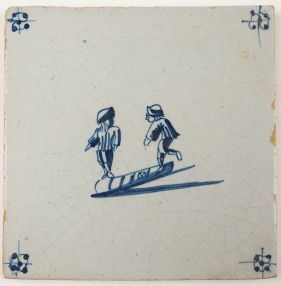 Antique Delft child's play tile in blue with two children playing a game of hopscotch, 18th century