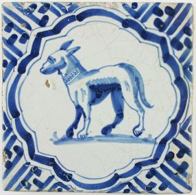 Antique Dutch Delft tile in blue with a dog wearing a collar, 17th century