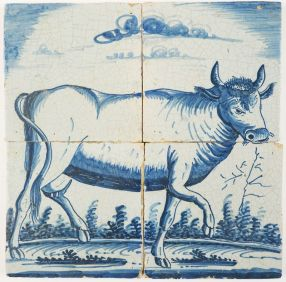 Antique Delft tile mural with a cow facing to the right, early 19th century