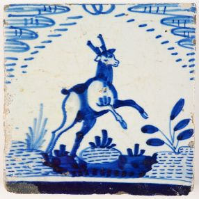 Rare antique Delft tile with a deer in blue in a so called Rotterdam open air landscape, early 17th century