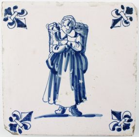 Antique Dutch Delft tile with a woman carrying goods, 17th century