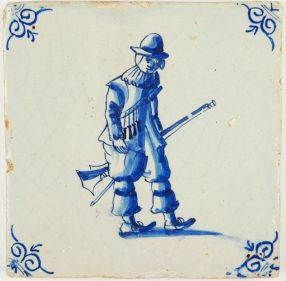 Antique Delft tile in blue with a soldier carrying his rifle, 17th century