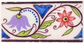 Antique polychrome Delft border tile with a tulip and a chalice - type II, 19th century