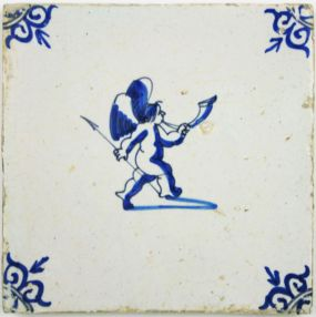 Dutch Delft tile with Cupid holding an arrow and blowing the horn