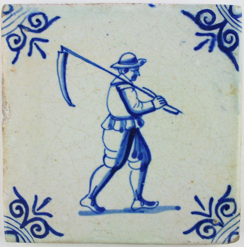 Dutch Delft tile depicting a farmer carrying a scythe